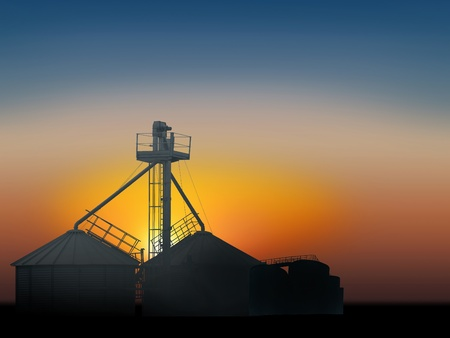 metal structure of grain silo in the sunset