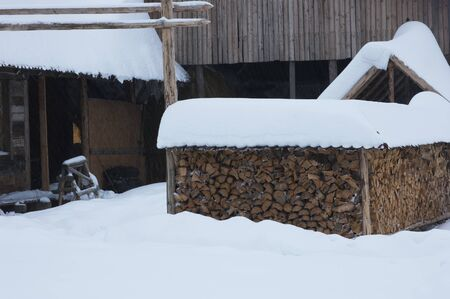 forest cottage with firewood in the winter season Stock Photo