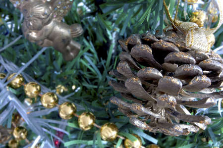 christmas tree decorated with golden pine cones