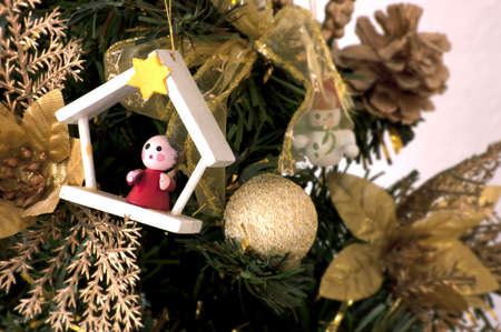 christmas tree decorated with wood toys Stock Photo