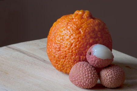 fresh lychees with a orange with beautiful texture