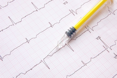 electrocardiogram with colored syringe suggesting a heart issue treatment Stock Photo - 17648057