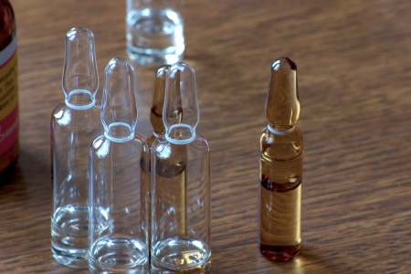 close up with different vials in a brown background Stock Photo - 17783673