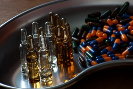 bunch of drug in form as vials and capsules Stock Photo - 17783675