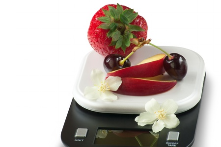 vivid colored fruits on kitchen scale