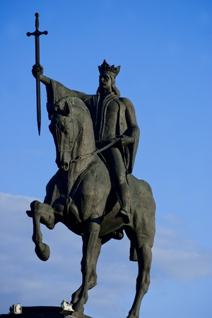 cel: romanian national hero Stefan cel Mare holding the holy cross in his hand while riding his horse
