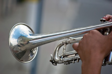 musician hands exploiting the trumpet Stock Photo