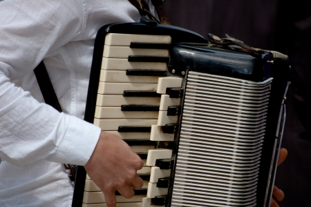 manipulating: male hands manipulating the accordion Stock Photo