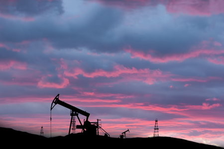 exploited: exploited oil field on sunset with silhouettes