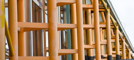 steelwork: close view of orange painted metal structure Stock Photo