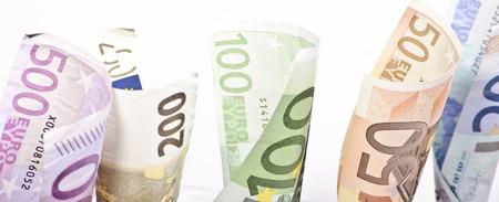 European banknotes of different value rolled on white background Lizenzfreie Bilder