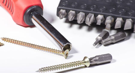 home related: home related tools screwdriver and wood screws