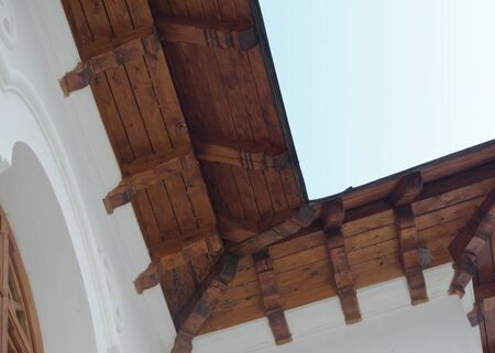 revealing: roof details revealing resistance wood beam and white wall Stock Photo