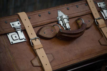 antique suitcase: brown vintage suitcase made of leather and metallic closures Stock Photo