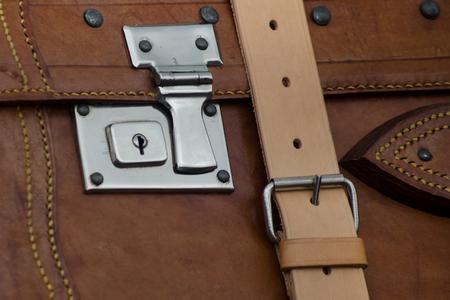 brown vintage suitcase made of leather and metallic closures Lizenzfreie Bilder