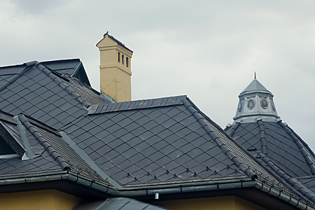 modern black tin roof with one chimney