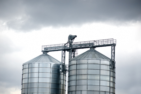 silos: metallic structure representing two silver agricultural silos