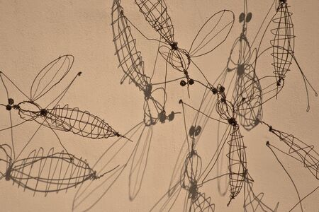 gigantic: gigantic mosquito made of iron wire on the wall