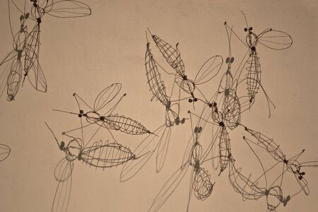 gigantic mosquito made of iron wire on the wall