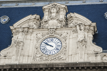 old facade clock with various architectural details