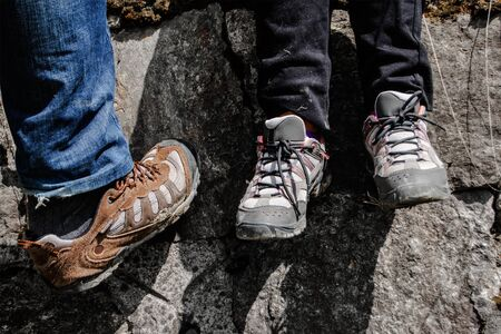 hiking shoes: hiking shoes with stone wall in background