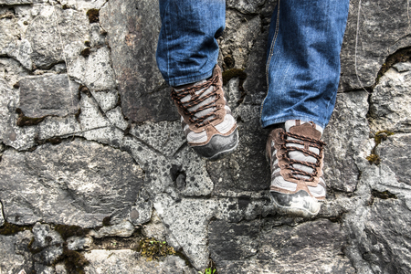 hiking shoes with stone wall in background