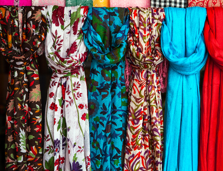 Colorful scarves at a market in India. Colors of textiles.
