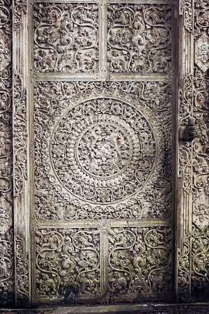 front elevation: old wooden door with carving on Bali