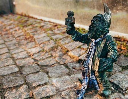 subversive: little bronze gnome statue, Poland. Wroclaw dwarfs. Stock Photo