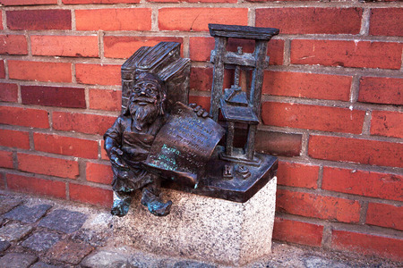 subversive: funny gnome statue, Poland, Wroclaw dwarfs.