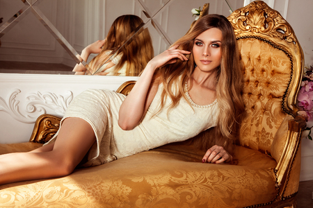 Sexual young woman posing in a luxurious classic interior. Fashion style Stock Photo