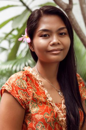 young beautiful Balinese woman, looking at camera.