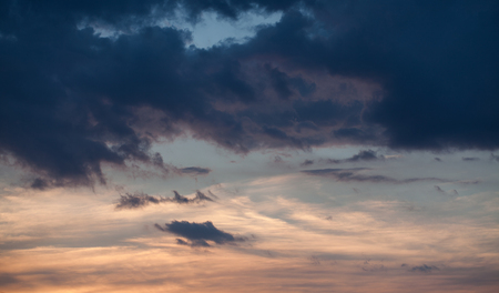 Abstract nature background. Dramatic and moody pink, purple and blue cloudy sunset sky. Stock Photo