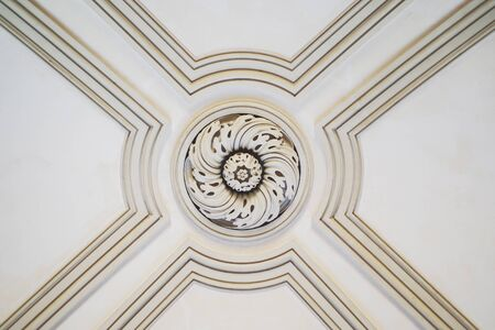 decorative ceiling detail with floral motif