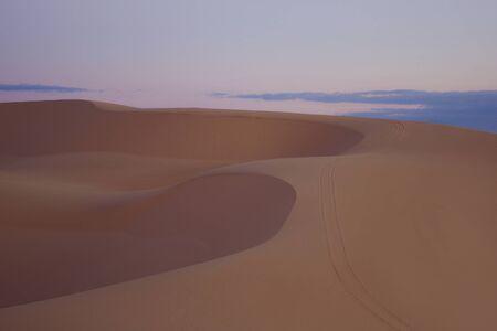 hummock: Desert landscape on sunrise in Vietnam. Soft sunlight over ridges and shapes of sand dunes Stock Photo