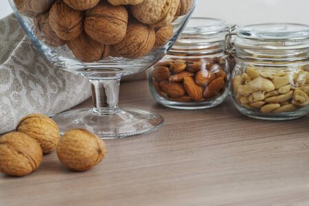 bonbonniere: Walnuts in glass bonbonniere  in the form of a wineglass, almonds, pine nuts and cashews in glass jars
