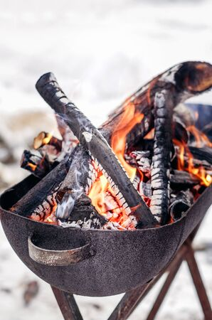 Charcoal preparing for making bbq in mangal outdoor. Bonfire in metal bowl