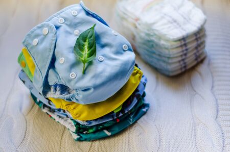 Stack of reusable nappies. Ecological trend for baby care. Washable cloth diapers.
