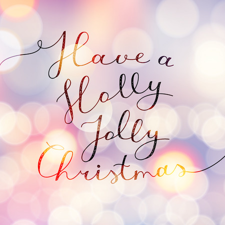 christmas gold: have a holly jolly christmas, vector lettering, handwritten text on blurred background with lights