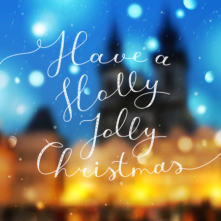 have a holly jolly christmas, vector lettering, handwritten text on blurred prague view and snowfall