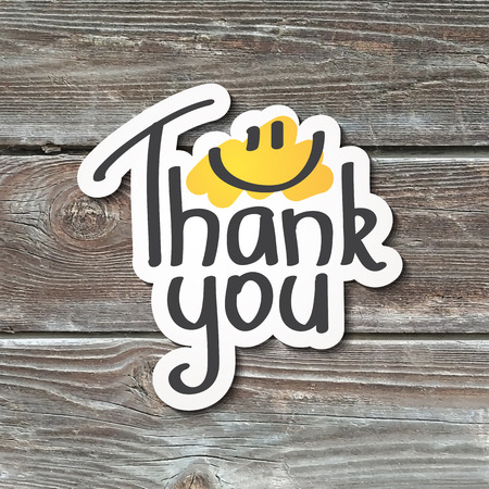 smiles: thank you, lettering with smile, written text, paper sticker on realistic wood texture Illustration