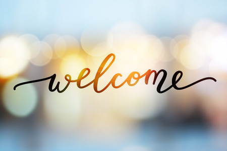 welcome vector lettering on blurred lights background