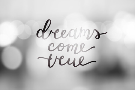 dreams come true, vector lettering on blurred background Illustration