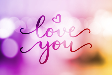 love you, vector lettering on blurred lights background, valentine card template
