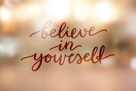 believe in yourself, lettering on golden blurred background of lights