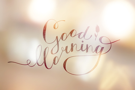 Good morning lettering on golden blurred lights.