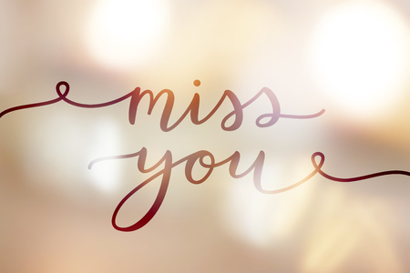 I miss you, lettering on golden blurred background of lights Vectores