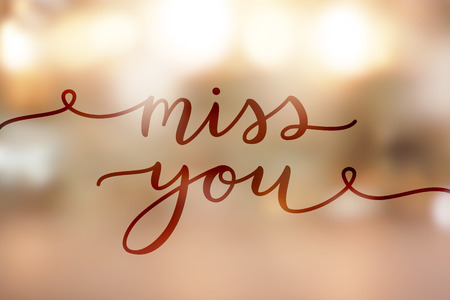 I miss you, lettering on golden blurred background of lights