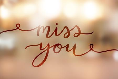 I miss you, lettering on golden blurred background of lights Illustration