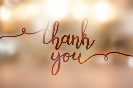 A thank you, lettering on golden blurred background of lights Vectores